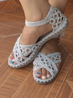 Once I've figured out how to crochet onto rubber soles, I have to figure out how to make these.  I love them!
