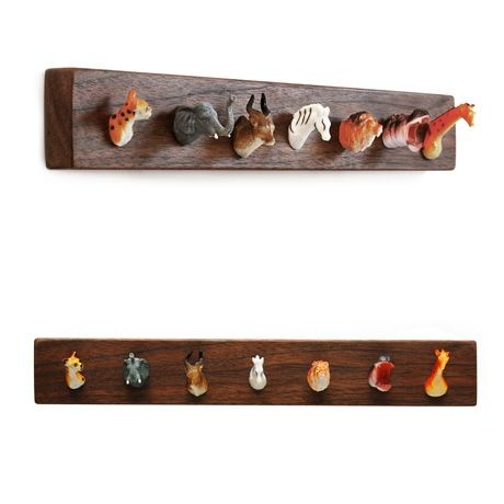 Witty and wonderful, the Pack Rack jewelry or key rack uses tiny plastic animal heads for hooks on wall-mountable black walnut salvaged from local cabinetry shops. Friends of the safari, tiger, elephant, antelope, zebra, lion, hippopotamus, and giraffe will guard your jewelry and keys. Comes wall-mount ready, packed in a gift box. Handmade in Brooklyn, New York by designer, Steph Mantis.
