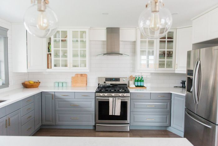 A gray and white budget friendly kitchen makeover using IKEA cabinetry, marble like quartz countertops, subway tile backsplash, and gold hardware. A timeless, bright and classic kitchen design / renovation! Click through to the blog for the full source list and DIY how-to's!