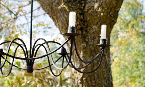 A candelabra adds and element of cozy to your backyard this fall!