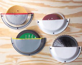 DIY Tutorial - Blade & Disc Holder made out of pie tins that have been cut in half and attached to the wall.