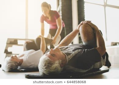 image result for older couple doing yoga in gym