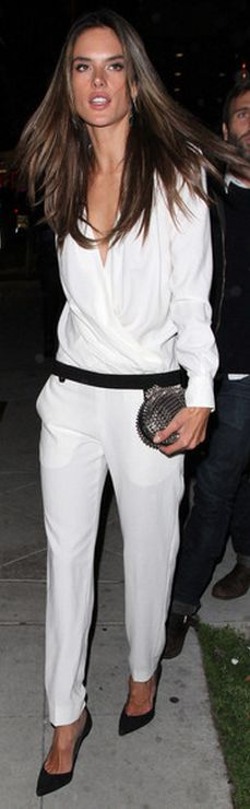 Who made Alessandra Ambrosio's white pants, white wrap long sleeve top, and spike black clutch handbag that she wore in West Hollywood?