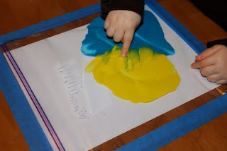 Finger Painting Bags-painting without the mess! I am definitely going to try this.