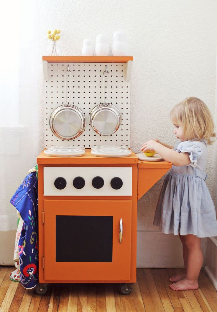 Play kitchen! Love how simple! love having wheels on it so you can move it where ever you want and the 2 shelves make room for play and storage