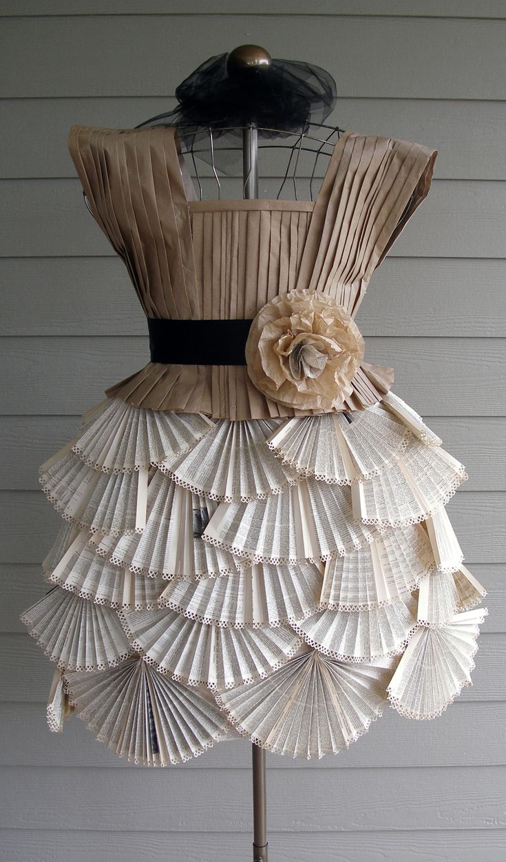 Paper dress made from old book pages and packaging for Diy from recycled materials