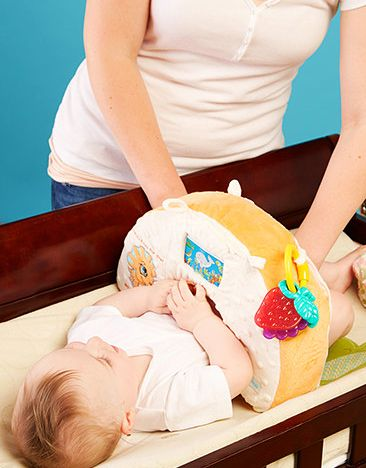Snuggwugg Diaper Changing Tips with Snuggwugg Baby pillow. The BEST Baby Shower gift.