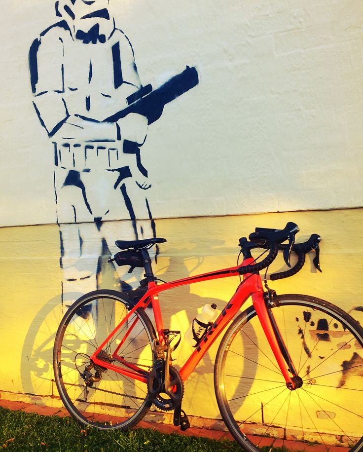 Who needs a bike lock with this guy? Which is your pic of the 2 pics #starwars or #gameofthrones? #mtstromlo in #canberra was a mix of both at sunrise today a stormtrooper on guard and cloud looming like a wall of ice above the mountains. Great morning. #cyclinglife #trek