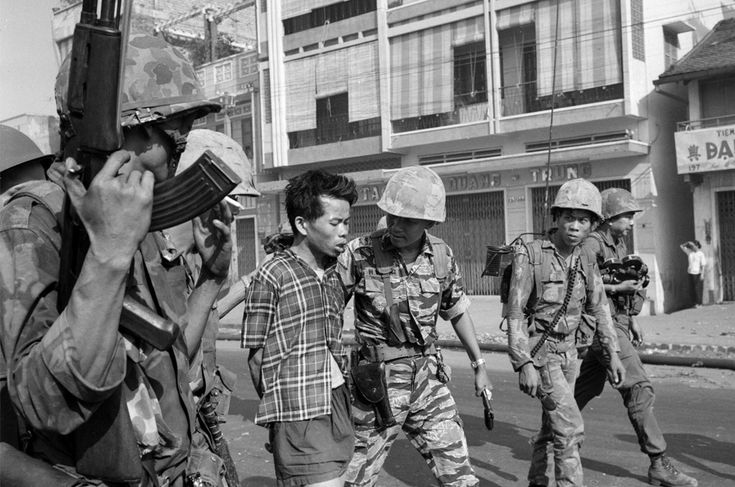 South Vietnamese forces escort suspected Viet Cong officer Nguyen Van Lem (also known as Bay Lop) on a Saigon street Feb. 1, 1968, early in the Tet Offensive. (AP Photo/Eddie Adams