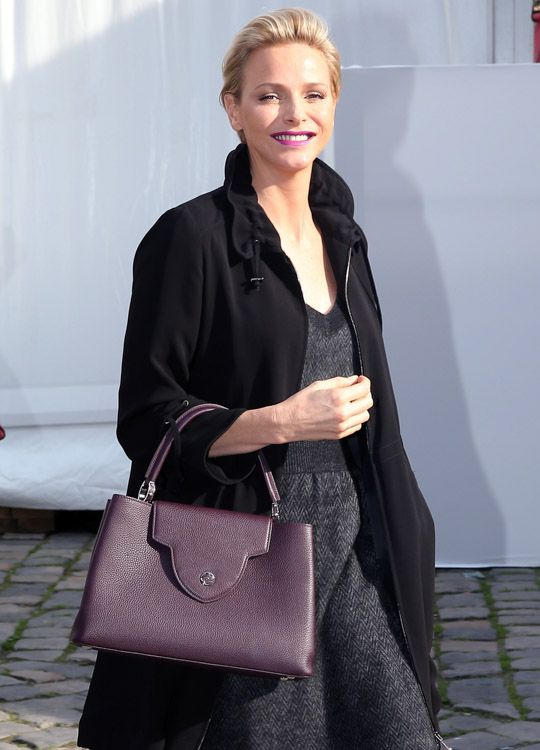 at the Vuitton show, Princess Charlene of Monaco demonstrated how to carry the Louis Vuitton Capucines Bag with the front flap exposed and t...