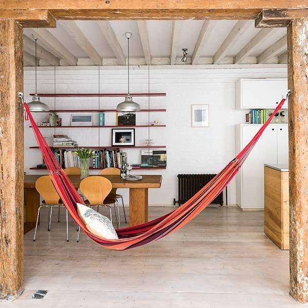 indoor hammock red hammock in white beamed room