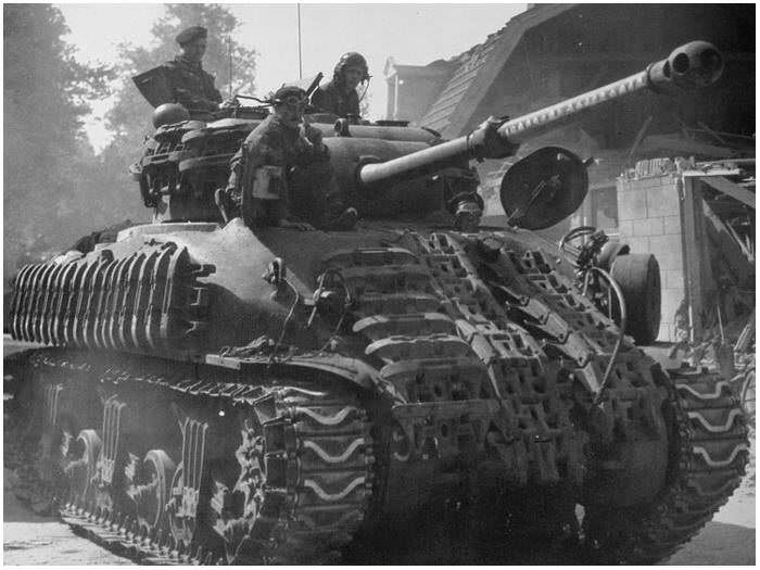 Sherman Firefly of the 5th Canadian Division carrying Churchill tracks as extra armour. Putten, Holland, April 18th 1945