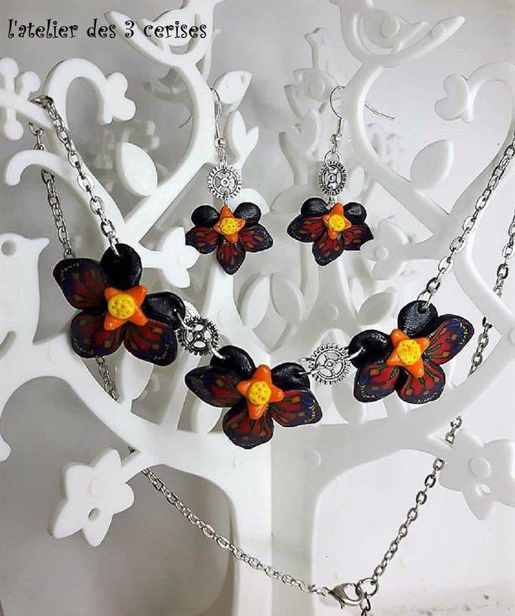 Parure orchidées rouges en fimo steampunk de la boutique latelierdes3cerises sur Etsy