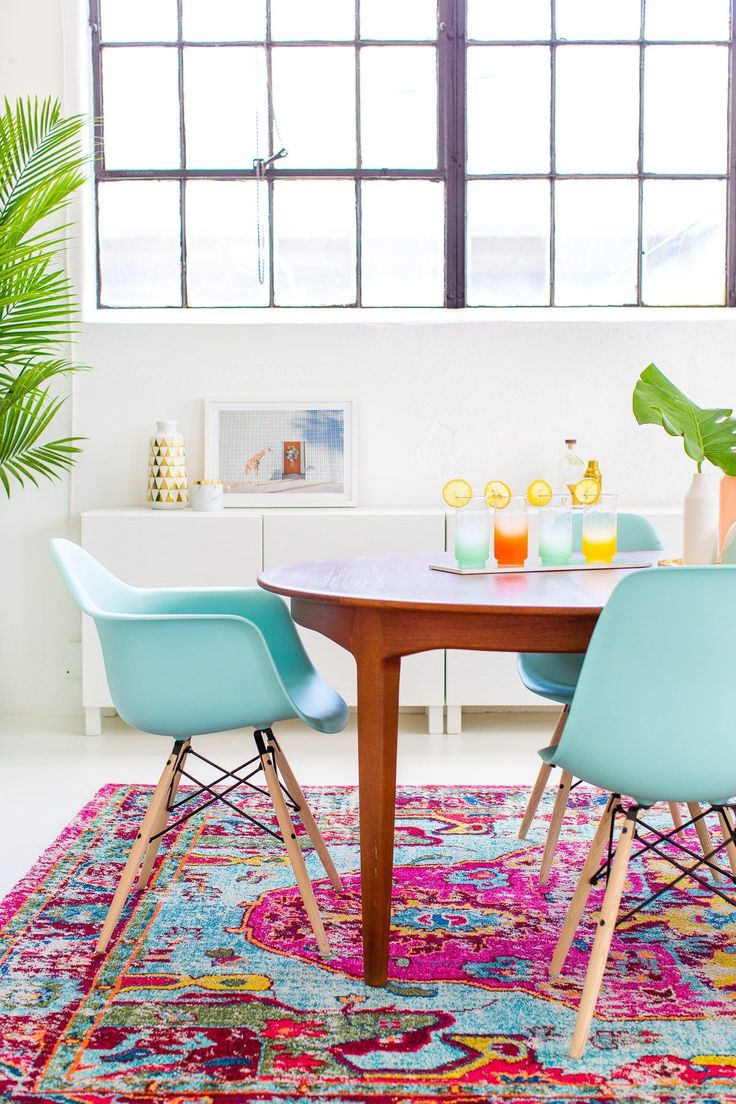 Dining room makeover with tons of turquoise, aqua, bright colors, white walls, mcm furniture // by Sugar & Cloth