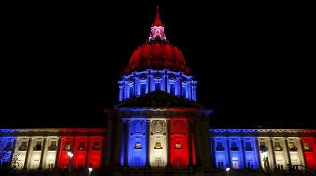 San Francisco City Hall is lit up with blue, white and red, the colors of the French flag, - Stephen Lam/Reuters