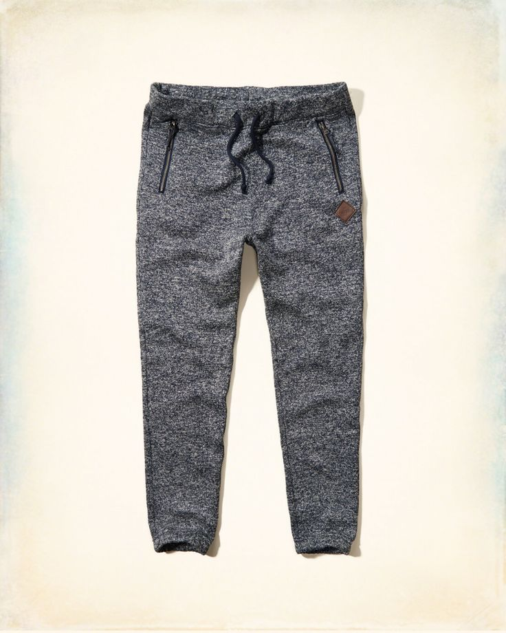 Upgrade your comfy sweats with sweater fabric, comfortable cinched cuffs and edgy zipper pockets, a drawstring waist and a logo tab on left leg, Slim Fit, Imported