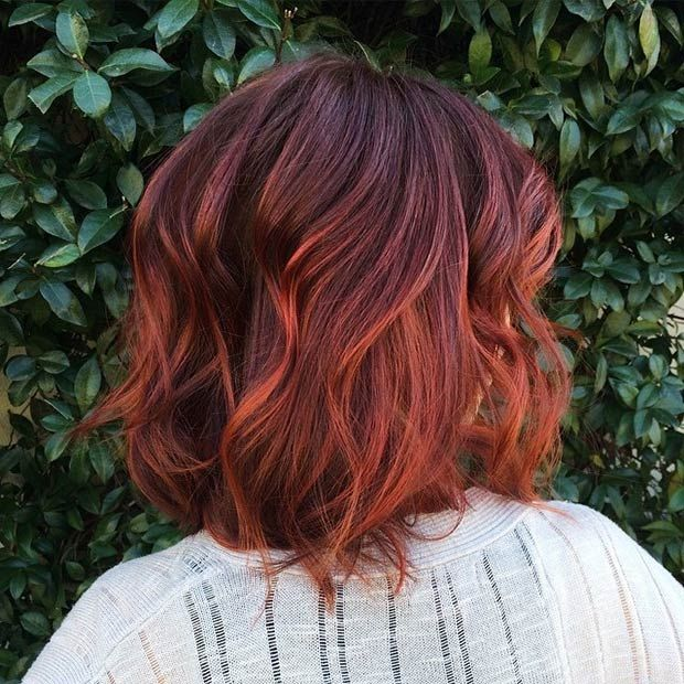 Dark brown, copper and red ombre bob for wavy hair