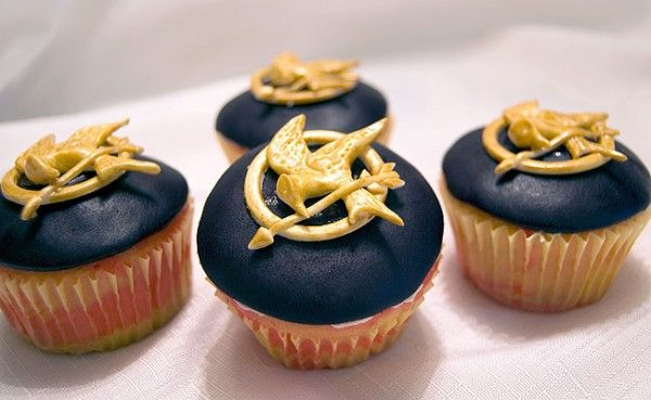 Hunger Games cupcakes. I think the chances of me being able to make a mocking jay pin out of fondant are about equal to the odds of me surviving the hunger games...
