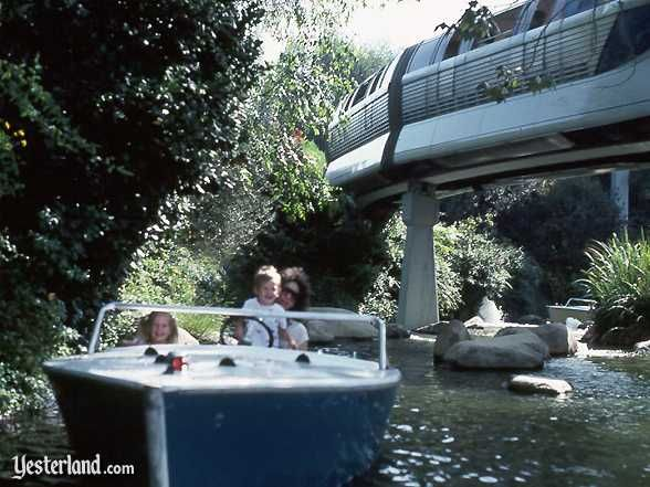 The Monorail whizzes above the Motor Boat Cruise at Disneyland | Yesterland