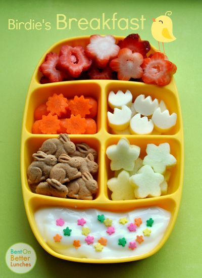 summer morning bento of fresh cut strawberry flowers, carrot suns, cheese tulips, bunny grahams, apple blossoms, and yogurt with a garden of sweet sprinkles.