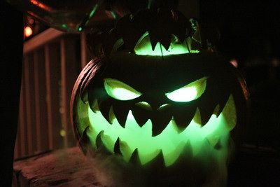 Halloween party decor: jack-o-lantern Pumpkin, dry ice and glowsticks.