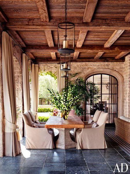 Love the traditional, rustic feel of this covered outdoor dining room.