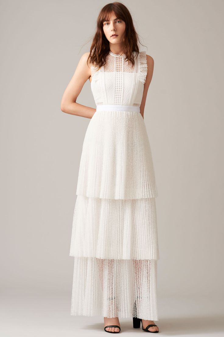 High-street wedding dress inspiration: Whistles debuts bridal collection. Tiered wedding dress. See every single look: http://www.harpersbazaar.co.uk/bazaar-brides/news/g37330/whistles-wedding-dresses-collection-revealed/?slide=2