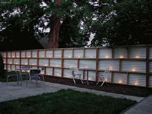 corregated metal fence on top for privacy