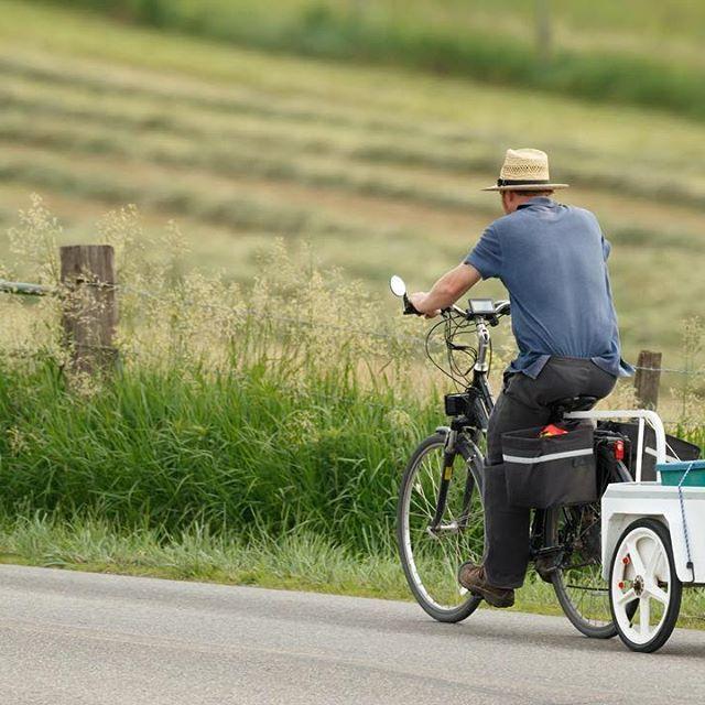 A Young Amish Man Rides A Bike Towards Berlin Ohio Rideabike