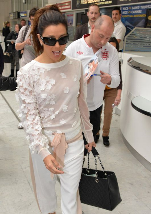 Eva Longoria also chose not-so-basic black for her airport jaunt – her bag was a Chanel Grand Shopping Tote.