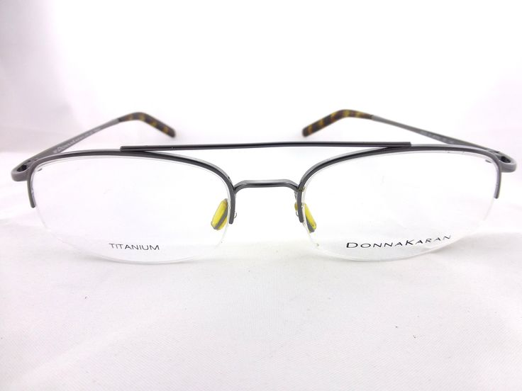 Donna Karan , Metal Titanium Eyeglass Frame, Mod. 8710. The item will be shipped with a replacement hard case free of charge.