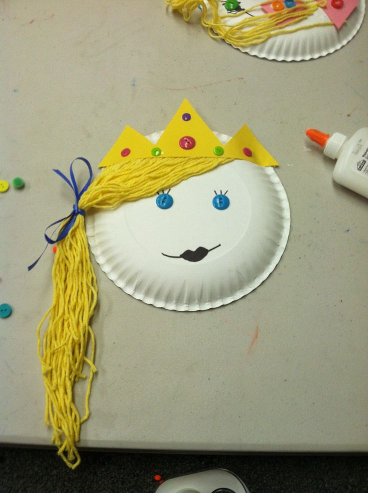 "Paper plate princesses. Construction paper crown, yarn hair, button eyes and ""jewels"" for crown, and ribbon."
