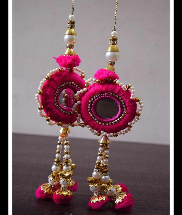 1 pair of Decorative Golden Hanging Beaded Tassel for Wedding Lehenga Dress, Blouses. This is embellished with rhinestone beads, mirrors and velvet beads.  This stunning Tassel can be used...