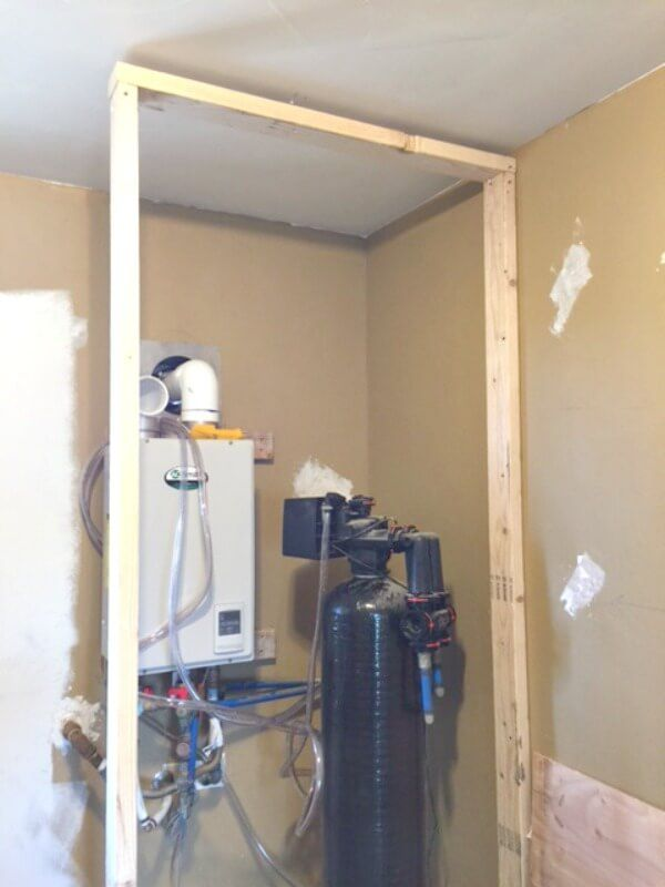 Hide An Unsightly Water Heater Basement Laundry Room Makeover Water Heater Closet Hot Water Heater Hide