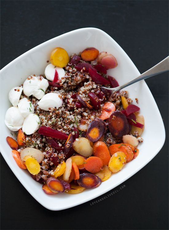 Another day, another unique salad. This one combining some rather unusual ingredients, including honey-roasted carrots, pickled beets, and dill. The beets and carrots make for a delightfully sweet salad. Darn right pretty too, with Trader Joe's rainbow quinoa blend and some stunning rainbow carrots. Just keep an eye on the carrots as they are roasting otherwise you'll end up with a big mess and a ruined cookie sheet. Curses! I only realized after the fact that we forgot the arugula th...