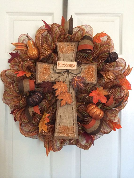 Large 24 Fall deco mesh wreath. Made with multi colored deco mesh and accented with different ribbons. Pumpkin amd squash accents throughout
