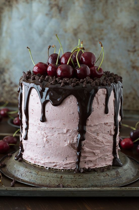 A 3 layer white cake filled with chopped cherries and cherry buttercream. Topped with a drizzled chocolate ganache and fresh cherries!