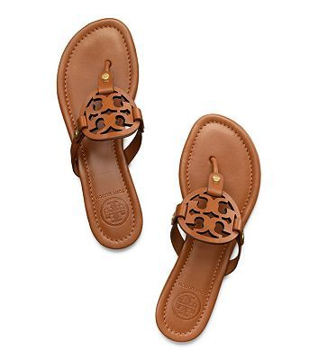 An extremely comfortable style for sunny days and warm getaways, our popular Miller Sandal — in richly colored leather with a laser-cut logo — goes with just about anything in your wardrobe. This chic