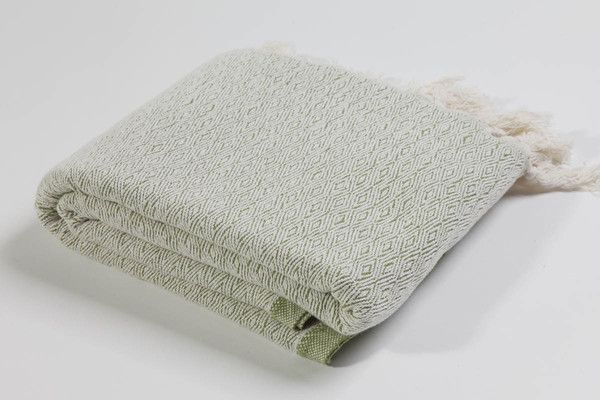 Ottoloom Lucerne throw in Sage Green.  Hand loomed in Southern Turkey with certified organic cotton.