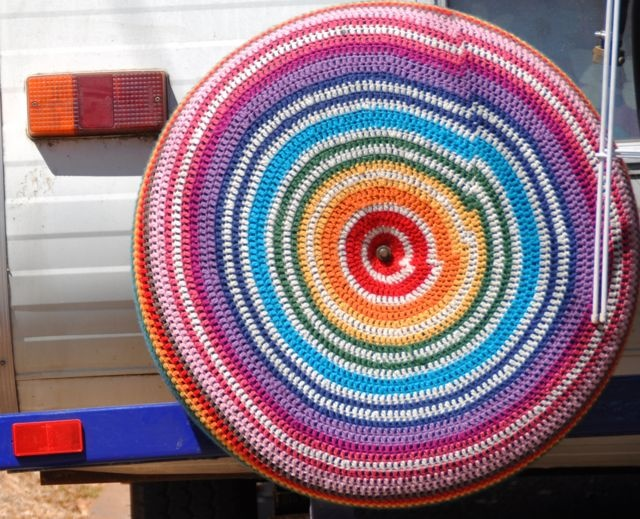 Crochet Yarn Bombed Tire Cover!  I would learn to crochet just to be able to do this.