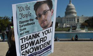 Demonstrators hold placards supporting Snowden during a 2013 protest against government surveillance in Washington, DC.