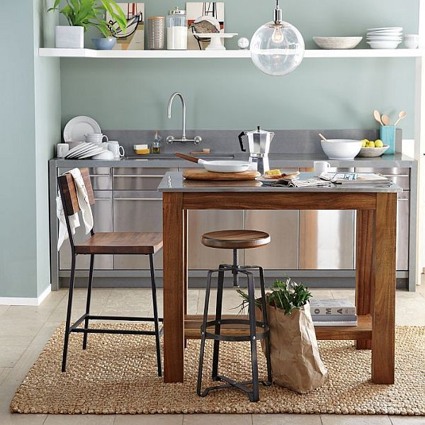 rustic industrial kitchen - small island, seagrass rug, grey-green paint