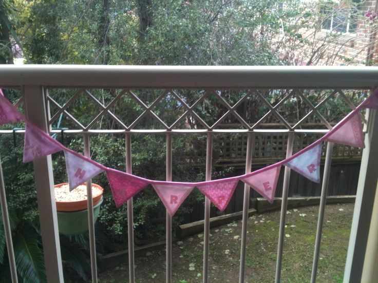 Pretty pink bunting with the child's name appliqued on individual flags.