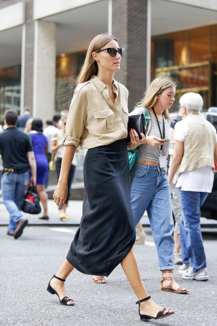 Navy skirt with a silk beige buttondown and Gucci sandals. | @andwhatelse