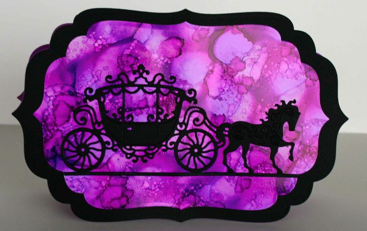 Tattered Lace Lace Carriage die cut card on an alcohol ink Spellbinders die cut background.