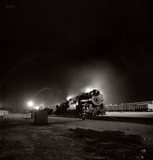 """March 1943. """"Barstow, California. A view of the Atchison, Topeka & Santa Fe yard at night."""" Medium-format negative by Jack Delano."""
