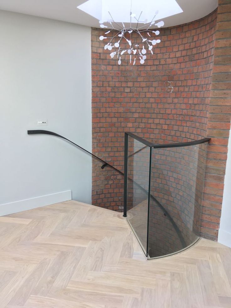 Bespoke Spiral staircase design to fit perfectly into this curved brick wall.
