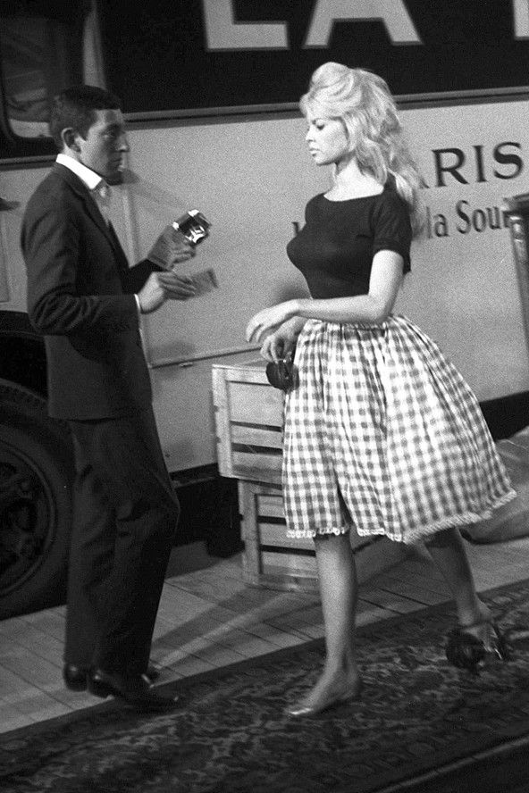 Brigitte and Serge Gainsbourg starred together in Voulez-Vous Danser Avec Moi. In this scene, Bardot's curves are accentuated with a full gingham skirt.