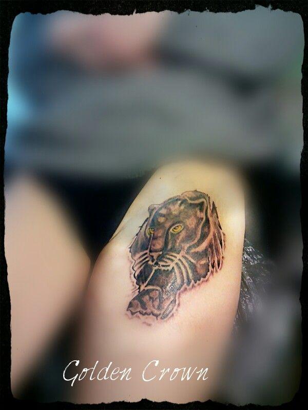 Puma tattoo.