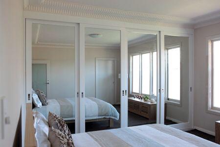 Timber framed sliding wardrobe doors with mirror insert